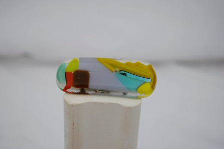 Mixed glass for an abstract pin